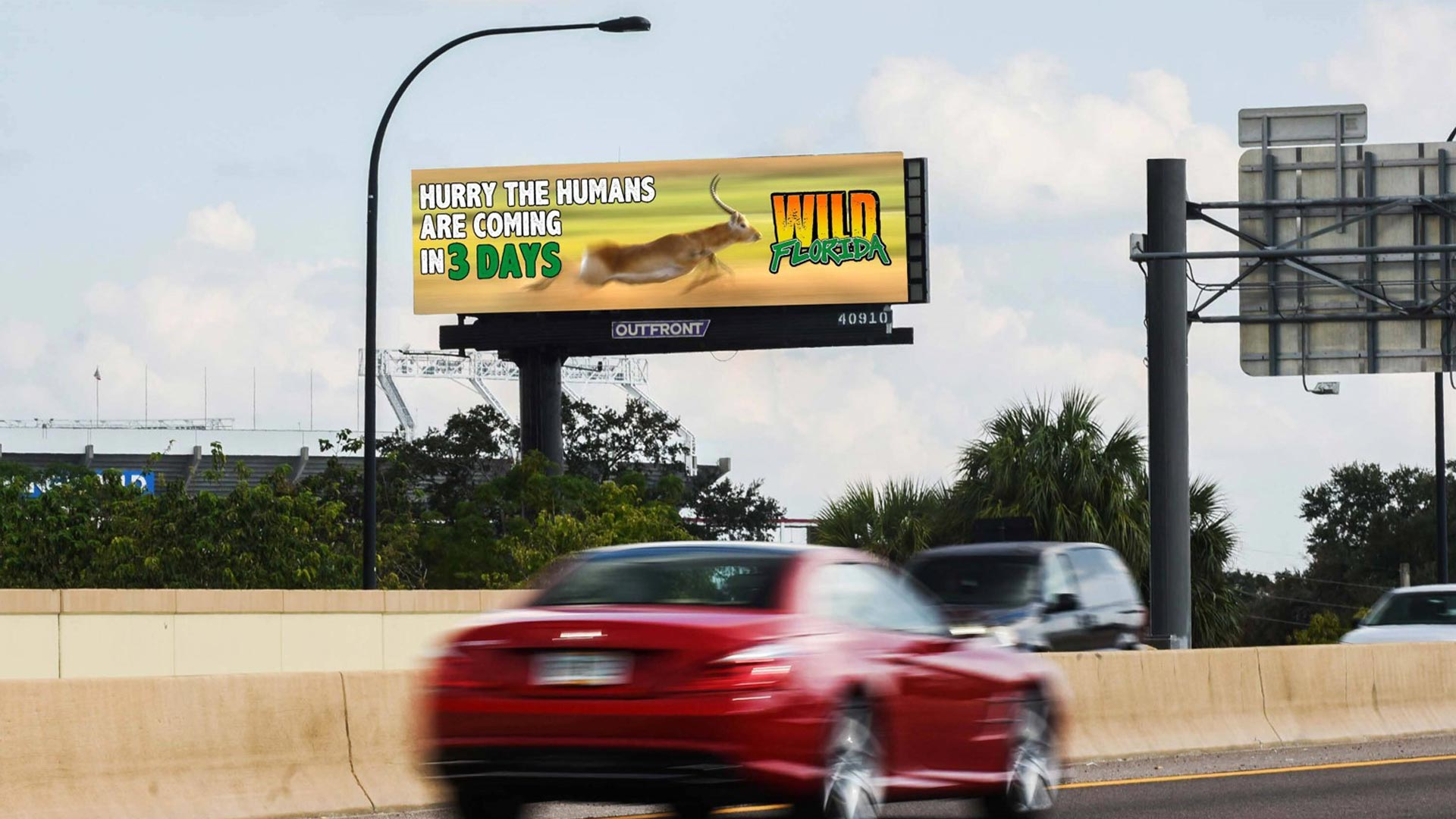 outfront studios creative digital design for wild florida out of home billboard advertising